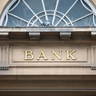 How Do Investment Banking Salaries Stack Up? — front of building with word BANK