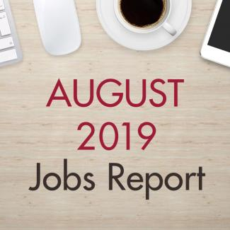 "An image of a desk with text that reads, ""August 2019 Jobs Report"""