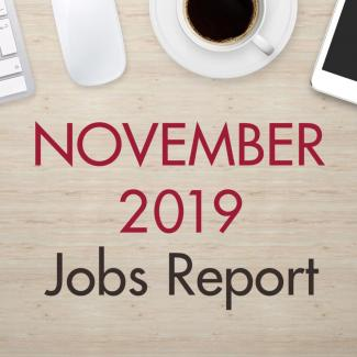 "An image of a desk with text that reads, ""November 2019 Jobs Report"""