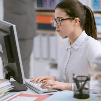 How to Hire an Office Clerk — worker at desktop computer