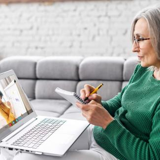 How Women Can Find a Mentor at Any Stage of Their Career — woman with laptop during video meeting