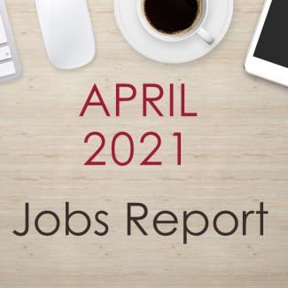 "Image of a desk with text that reads, ""April 2021 Jobs Report"""