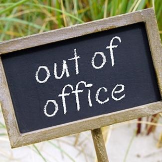"How to Craft an Effective Out-of-Office Message — blackboard with words ""out of office"""