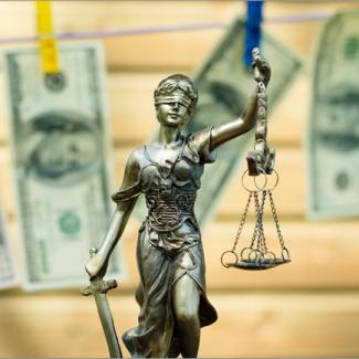 Statue and cash on clothesline symbolizing need for anti-money laundering jobs