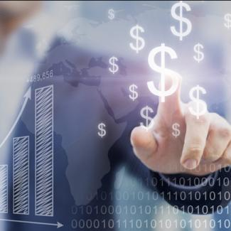 A man pointing to a screen with images of dollar signs and graphs.