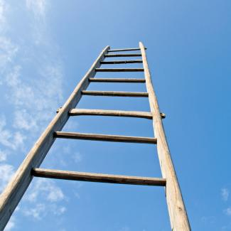 Start Your Career by Becoming an Administrative Assistant — View of ladder going up to the sky, representing an administrative assistant's career path